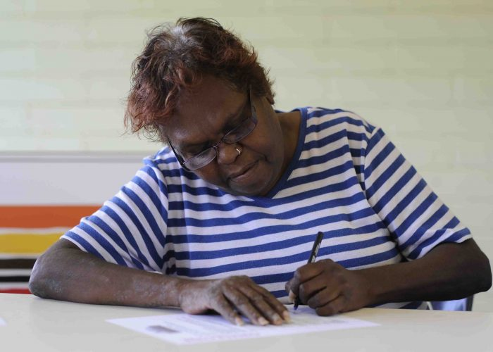 Ngarlawangga community member Maisey Hyland signs agreement