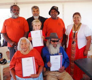 Wajarri people proudly showing their consent determination