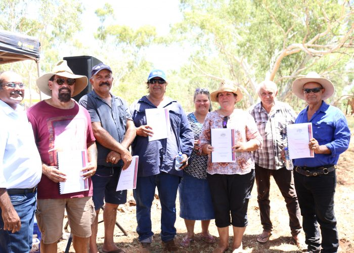 Palyku Traditional Owners hold their Native Title documents 12 March 2019